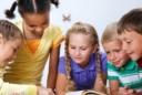 four kids reading