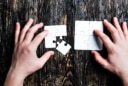 hands on white puzzles