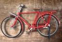 red bicycle brown wood wall