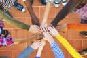 teamwork hands together above tile floor